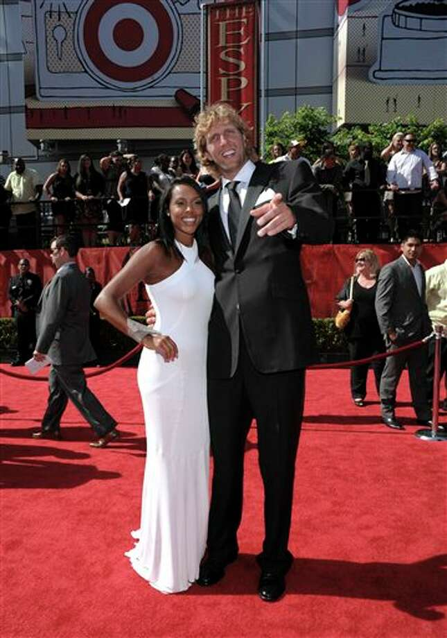 Dallas Mavericks Dirk Nowitzki arrives with a guest at the ESPY awards on Wednesday, July 13, 2011, in Los Angeles. (AP Photo/Dan Steinberg) Photo: Associated Press