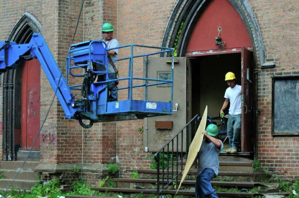 A crew from DiTonno and Sons work at Trinity Church during the salvaging of historic pieces and demolition in Albany, NY Wednesday July 13,2011.( Michael P. Farrell/Times Union )