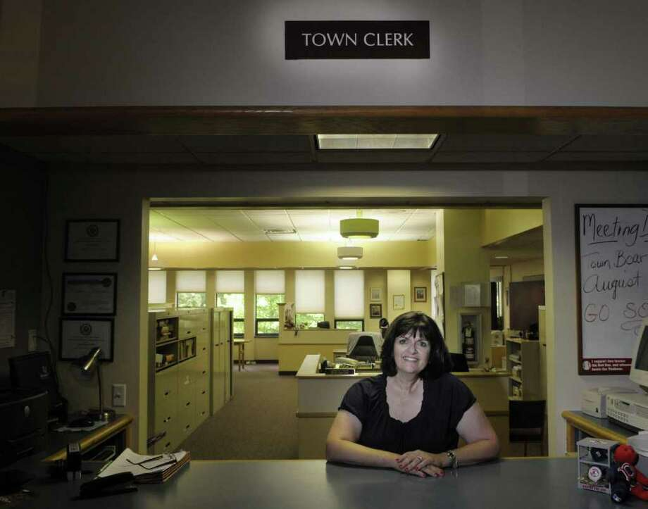Rosemary Centi, Guilderland town clerk poses for a photograph at the Guilderland Town Hall on Wednesday, July 13, 2011 in  Guilderland.  Centi will stay on as Town Clerk, but she will no longer do marriages. As a Catholic she believes marriage is a sacrament and should only be between a man and a woman. Two town judges will be doing all future marriages.  (Paul Buckowski / Times Union) Photo: Paul Buckowski  / 00013910A