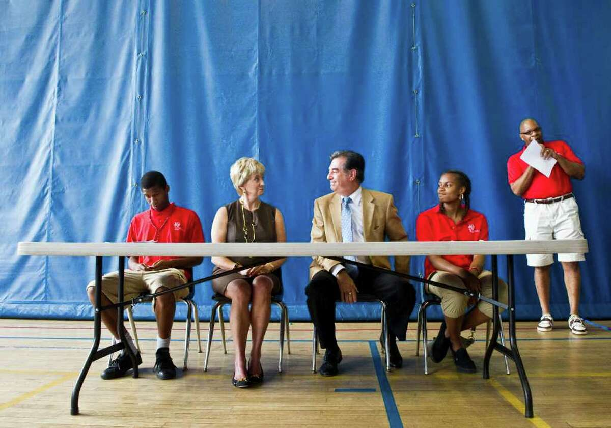 Yerwood Center CEO Eugene Campbelll, right, and teens including Keion Harris, left, and Anisa Forte, host Linda McMahon and Mayor Michael Pavia in Stamford, Conn., July 13, 2011. The Vince and Linda McMahon Family Foundation announced a multi-year grant to the center that will provide summer jobs for 60 teens.
