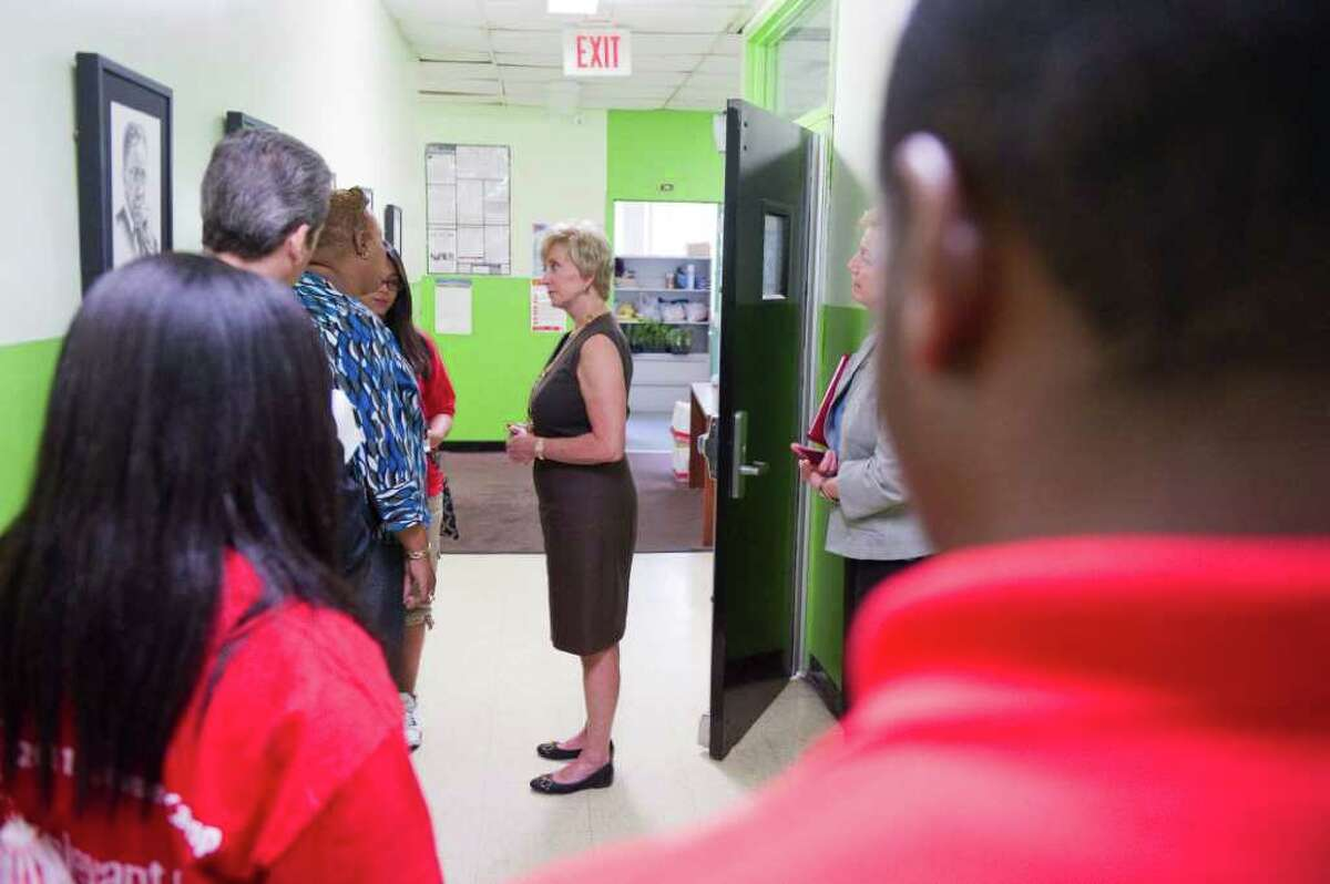 Linda McMahon tours the Yerwood Center in Stamford, Conn., July 13, 2011. The Vince and Linda McMahon Family Foundation announced a multi-year grant to the center that will provide summer jobs for 60 teens.