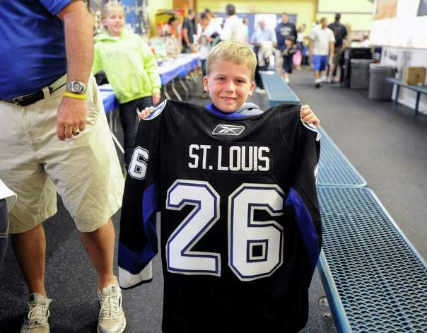 Tucker Williams, 6, of Greenwich, holds a Martin St. Louis jersey during The Big Assist III hockey game to benefit The Obie Harrington-Howes Foundation at Terry Conners Rink, Stamford, Wednesday night, July 13, 2011. Photo: Bob Luckey / Greenwich Time