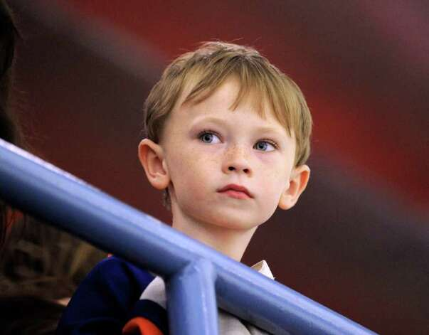 Thomas Waterbury, 6, of Stamford, watches the action during The Big Assist III hockey game to benefit The Obie Harrington-Howes Foundation at Terry Conners Rink, Stamford, Wednesday night, July 13, 2011. Photo: Bob Luckey / Greenwich Time