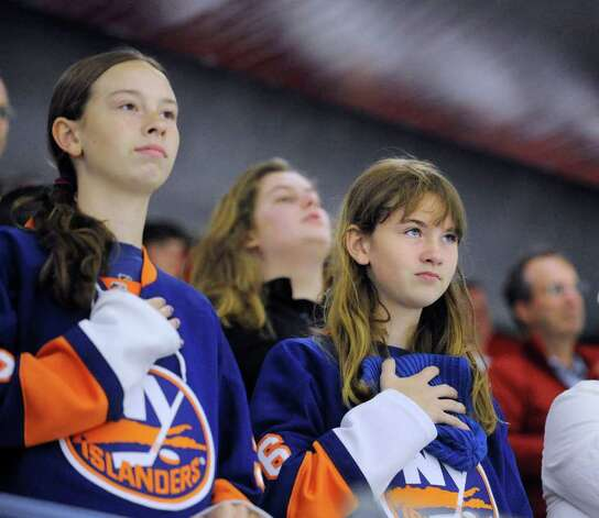 Islander fans during the National Anthem prior to the start of The Big Assist III hockey game to benefit The Obie Harrington-Howes Foundation at Terry Conners Rink, Stamford, Wednesday night, July 13, 2011. Photo: Bob Luckey / Greenwich Time