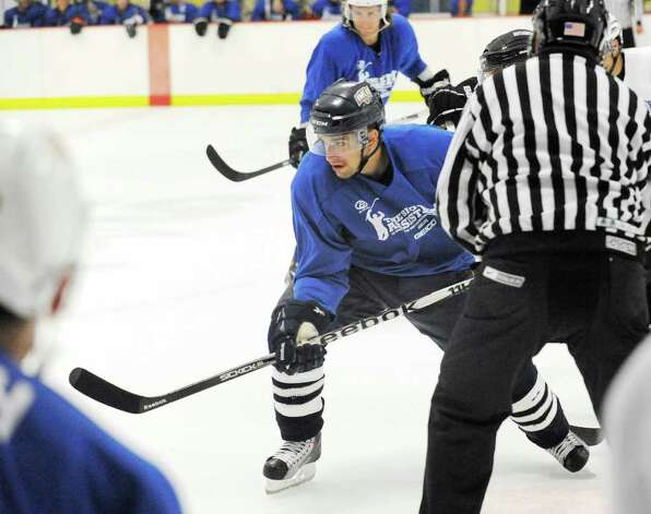 At center, Mark Arcobello of Team Blue in action during The Big Assist III hockey game to benefit The Obie Harrington-Howes Foundation at Terry Conners Rink, Stamford, Wednesday night, July 13, 2011. Photo: Bob Luckey / Greenwich Time
