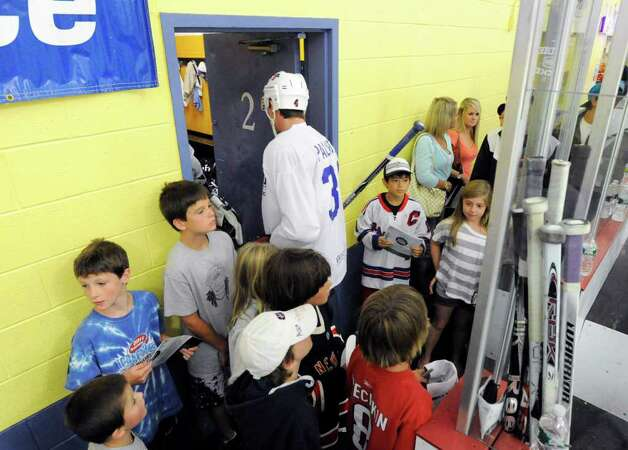 Autograph seekers in between periods during The Big Assist III hockey game to benefit The Obie Harrington-Howes Foundation at Terry Conners Rink, Stamford, Wednesday night, July 13, 2011. Photo: Bob Luckey / Greenwich Time