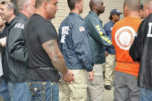 Federal agents escorts suspected members of an Albanian mob after a raid in Brooklyn. (U.S. Department of Justice photo)