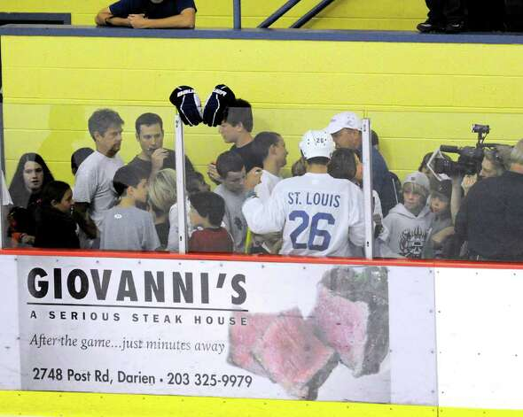 Riverside resident Martin St. Louis, # 26, gets mobbed by autograph seekers in between periods of The Big Assist III hockey game to benefit The Obie Harrington-Howes Foundation at Terry Conners Rink, Stamford, Wednesday night, July 13, 2011. Photo: Bob Luckey / Greenwich Time