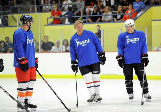 Glenn Anderson of Team Blue, center, is introduced during The Big Assist III hockey game to benefit The Obie Harrington-Howes Foundation at Terry Conners Rink, Stamford, Wednesday night, July 13, 2011. Photo: Bob Luckey / Greenwich Time