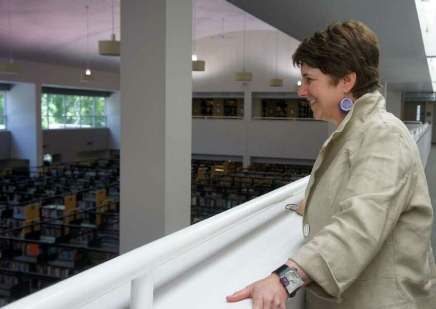 Maxine Bleiweis, library director of the Westport Public Library, surveys the first floor of the library on Monday, July 11, 2011.