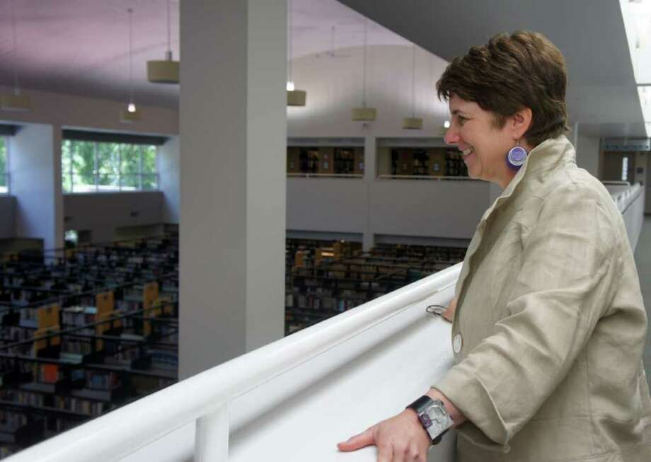 Maxine Bleiweis, library director of the Westport Public Library, surveys the first floor of the library on Monday, July 11, 2011. Photo: Paul Schott / Westport News