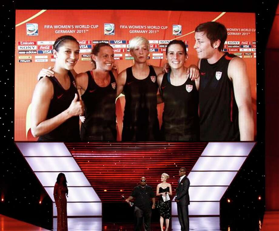 The U.S. Women's soccer team appear via video as Abby Wambach, R, accepts the award for Best Play from presenters L to R, Cee Lo Green, Amber Heard and Cam Newton at the ESPY Awards on Wednesday, July 13, 2011, in Los Angeles. (AP Photo/Matt Sayles) Photo: Associated Press