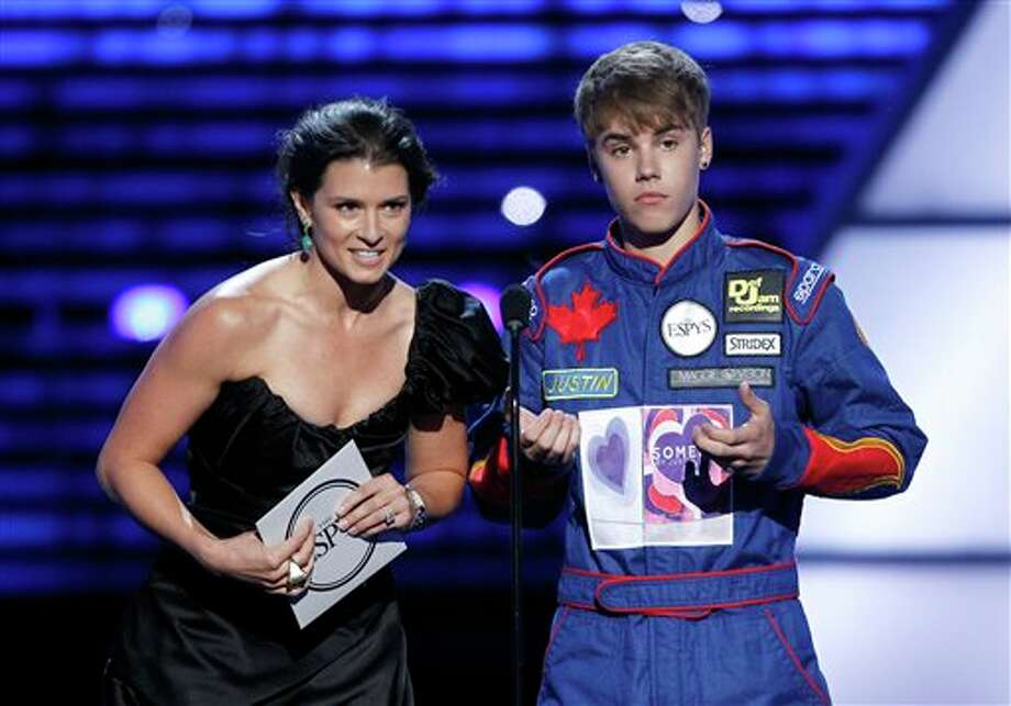 L to R, Danica Patrick and Justin Bieber present the award for Best Team at the ESPY Awards on Wednesday, July 13, 2011, in Los Angeles. (AP Photo/Matt Sayles) Photo: Associated Press