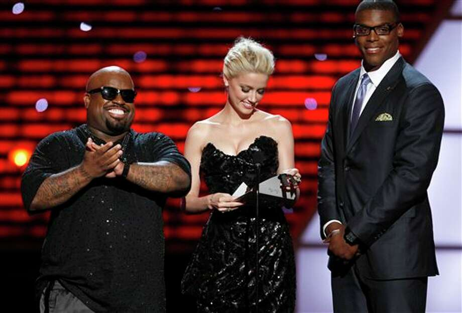 L to R, Cee Lo Green, Amber Heard and Cam Newton present the award for Best Play at the ESPY Awards on Wednesday, July 13, 2011, in Los Angeles. (AP Photo/Matt Sayles) Photo: Associated Press