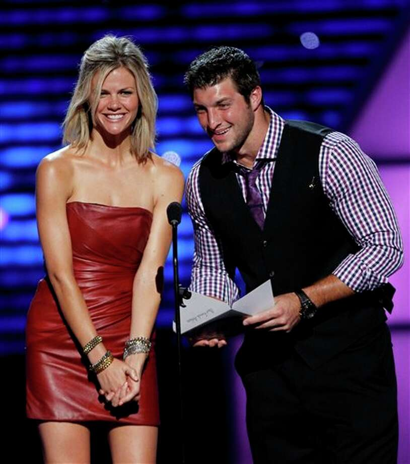 L to R, Brooklyn Decker and Tim Tebow present the award for Best Female Athlete at the ESPY Awards on Wednesday, July 13, 2011, in Los Angeles. (AP Photo/Matt Sayles) Photo: Associated Press