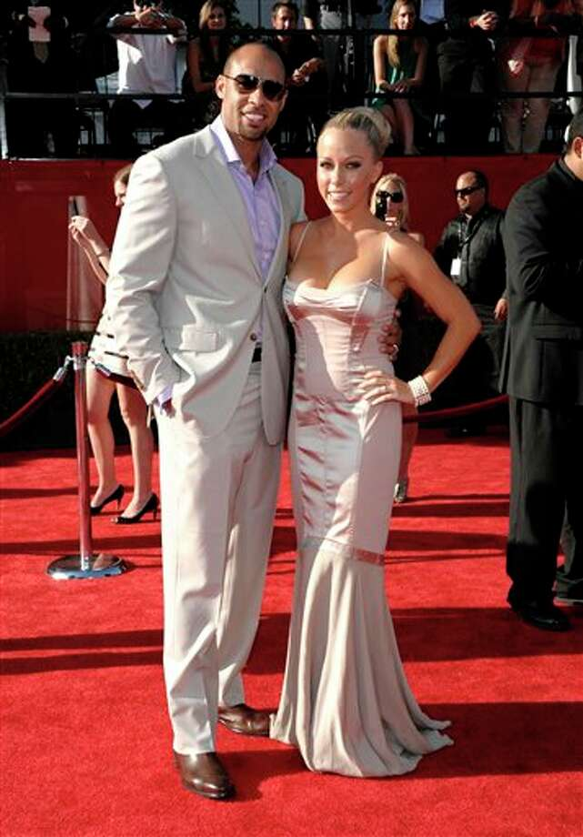 Hank Baskett, left, and Kendra Wilkinson arrive at the ESPY awards on Wednesday, July 13, 2011, in Los Angeles. (AP Photo/Dan Steinberg) Photo: Associated Press