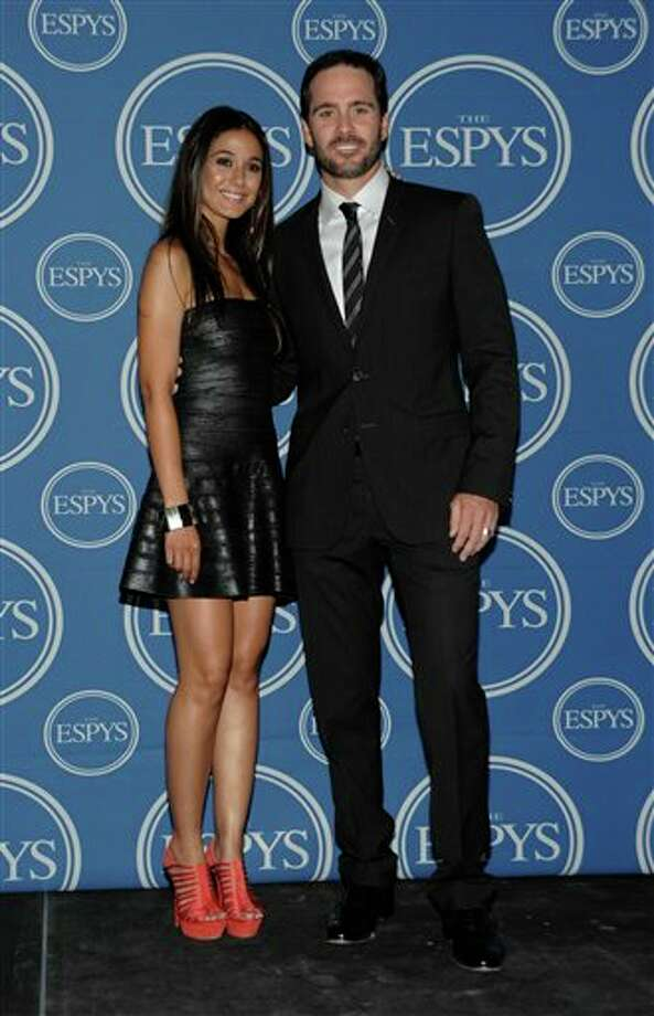L to R, Actress  Emmanuelle Chriqui and NASCAR defending champion Jimmie Johnson backstage at the ESPY awards on Wednesday, July 13, 2011, in Los Angeles. (AP Photo/Dan Steinberg) Photo: Associated Press