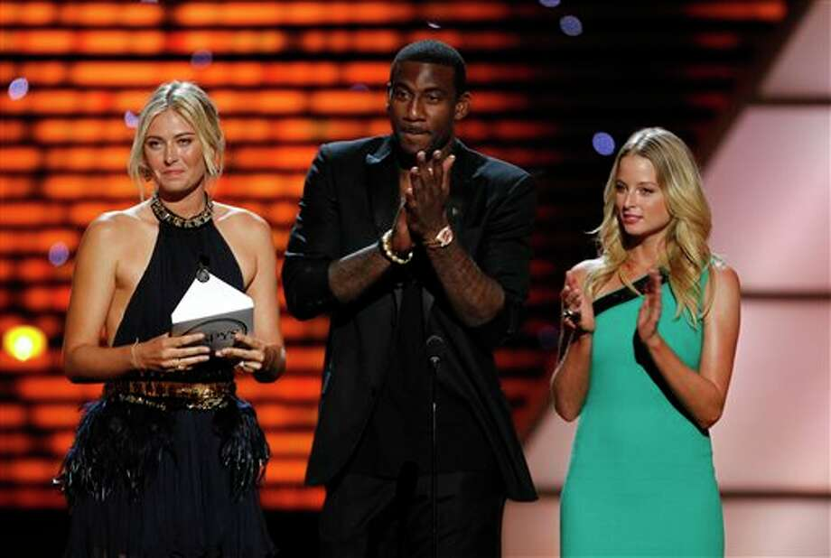 L to R, Maria Sharapova, New York Knicks Amare Stoudemire and Rachel Nichols present the award for Best Upset at the ESPY Awards on Wednesday, July 13, 2011, in Los Angeles. (AP Photo/Matt Sayles) Photo: Associated Press