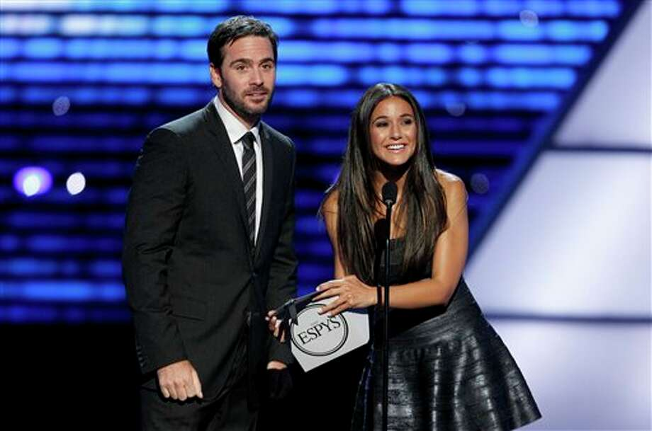 L to R, Jimmie Johnson and Emmanuelle Chriqui present the award for Breakthrough Athlete at the ESPY Awards on Wednesday, July 13, 2011, in Los Angeles. (AP Photo/Matt Sayles) Photo: Associated Press