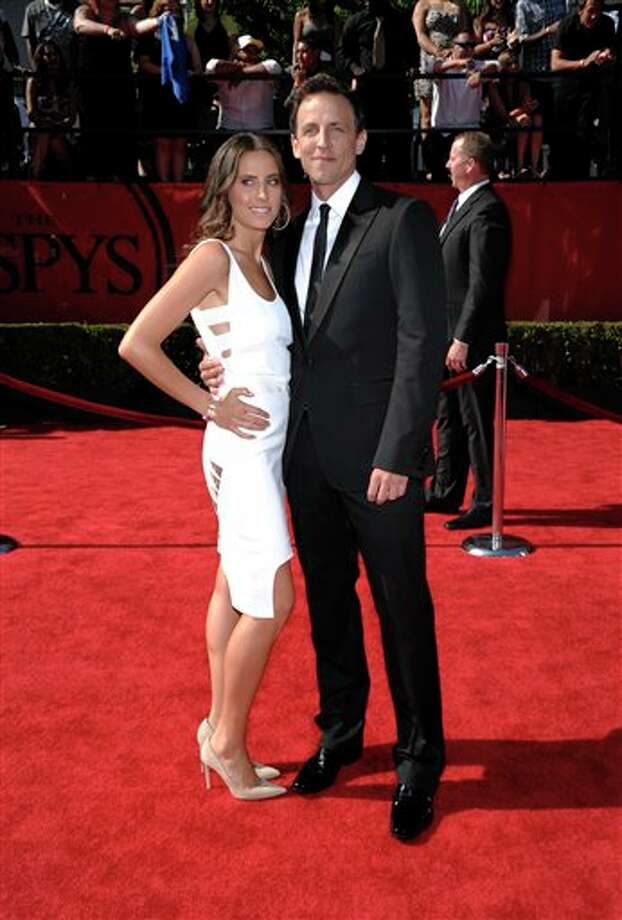 Seth Meyers arrives with a guest at the ESPY awards on Wednesday, July 13, 2011, in Los Angeles. (AP Photo/Dan Steinberg) Photo: Associated Press