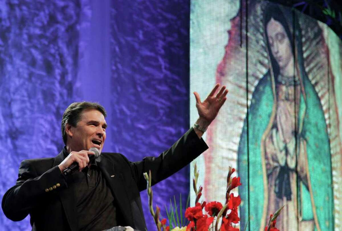 Gov. Rick Perry speaks during a United For Life event organized by a Hispanic anti-abortion group at the Los Angeles Memorial Sports Arena. He has used strong religious references in recent speeches as he weighs a run for president.