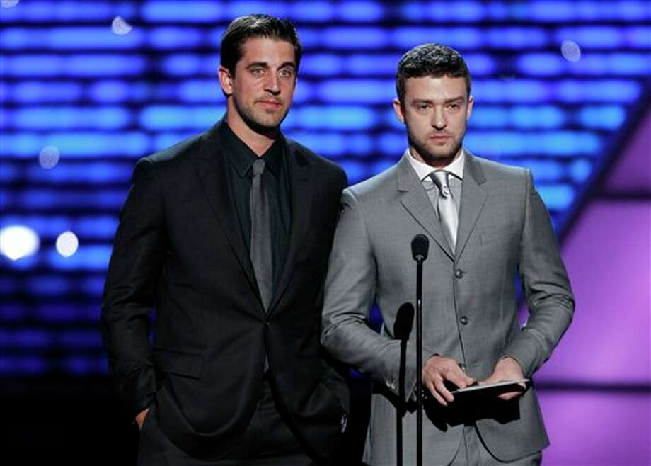 L to R, Green Bay Packers quarterback Aaron Rodgers and Justin Timberlake present the award for Best Male College Athlete at the ESPY Awards on Wednesday, July 13, 2011, in Los Angeles. (AP Photo/Matt Sayles) Photo: Associated Press