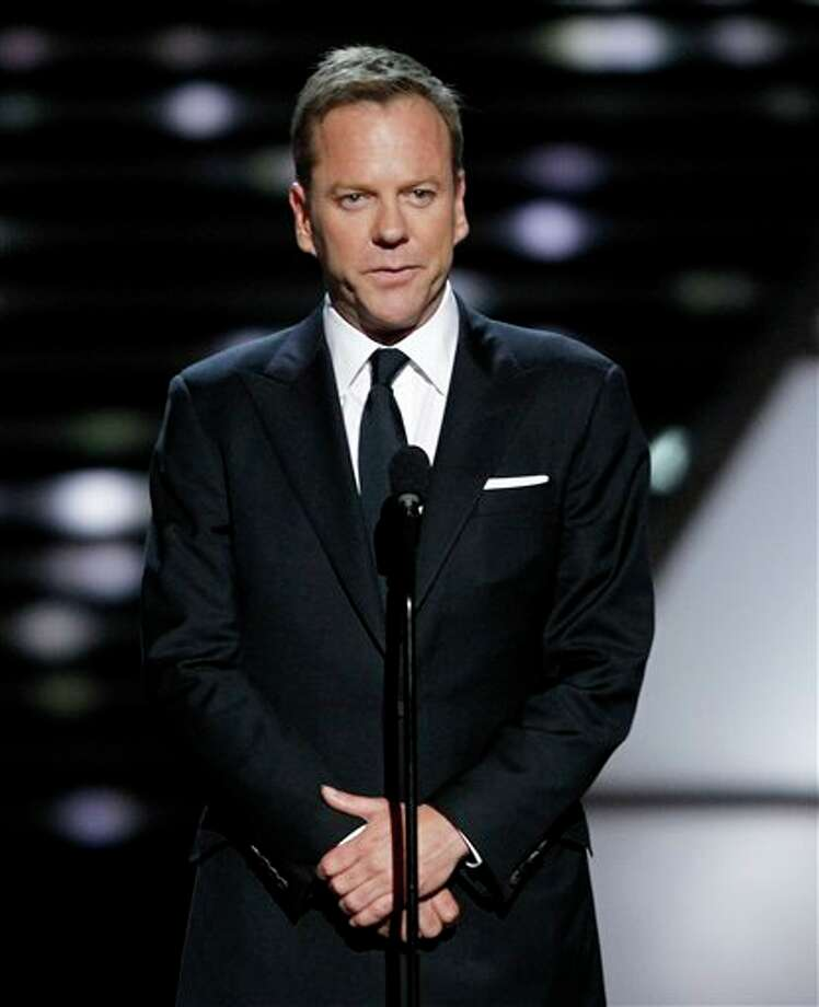 Actor Kiefer Sutherland presents the Arthur Ashe Award for Courage to Dewey Bozella at the ESPY Awards on Wednesday, July 13, 2011, in Los Angeles. (AP Photo/Matt Sayles) Photo: Associated Press