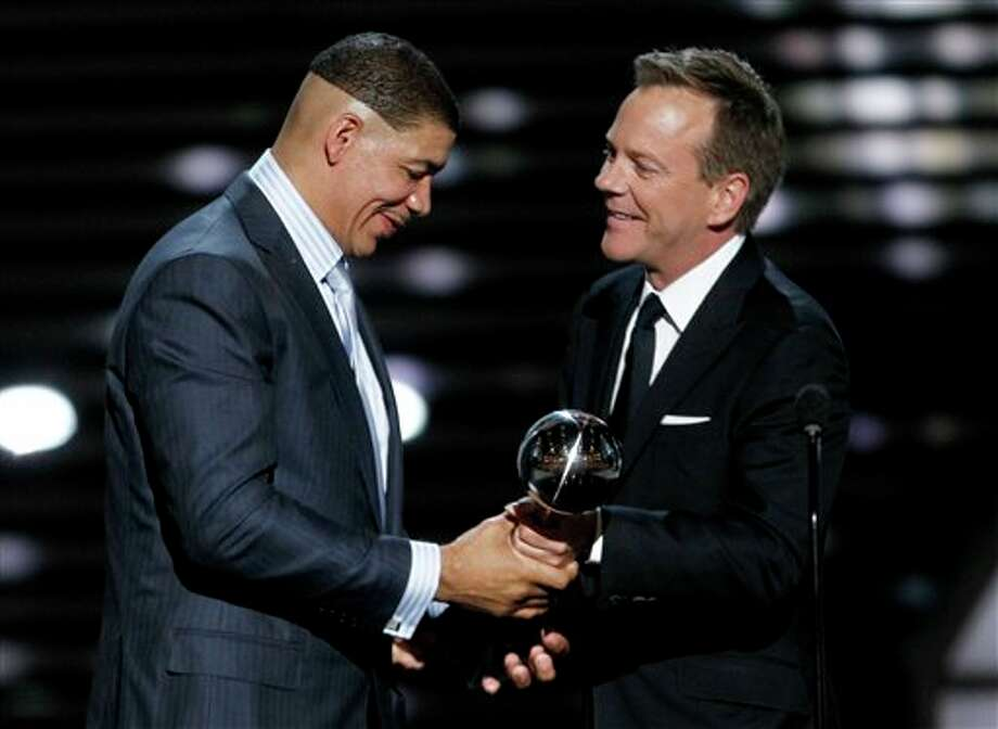 Dewey Bozella accepts the Arthur Ashe Award for Courage from Kiefer Sutherland at the ESPY Awards on Wednesday, July 13, 2011, in Los Angeles. (AP Photo/Matt Sayles) Photo: Associated Press