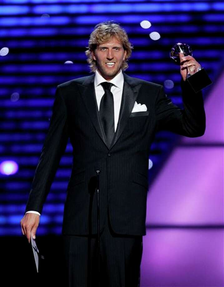 Dallas Mavericks Dirk Nowitzki accepts the award for Best Male Athlete at the ESPY Awards on Wednesday, July 13, 2011, in Los Angeles. (AP Photo/Matt Sayles) Photo: Associated Press