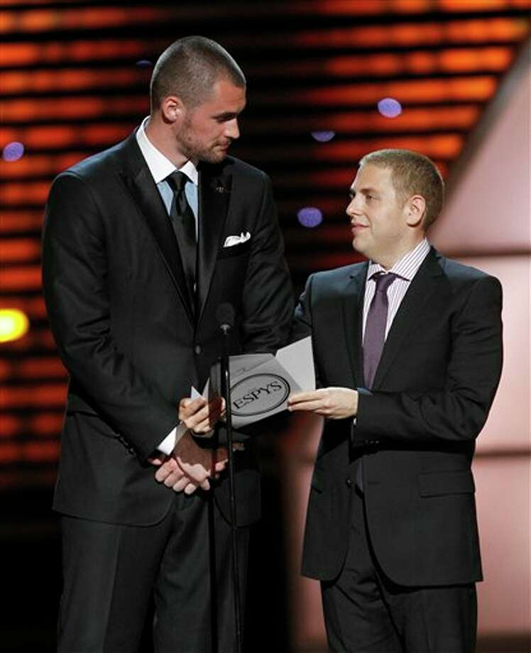 L to R, Minnesota Timberwolves Kevin Love and Jonah Hill present the award for Best Game at the ESPY Awards on Wednesday, July 13, 2011, in Los Angeles. (AP Photo/Matt Sayles) Photo: Associated Press