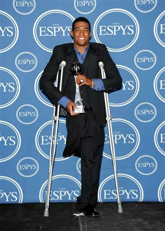 Anthony Robles poses with the Jimmy V Award for Perseverance backstage at the ESPY Awards on Wednesday, July 13, 2011, in Los Angeles. (AP Photo/Matt Sayles) Photo: Associated Press