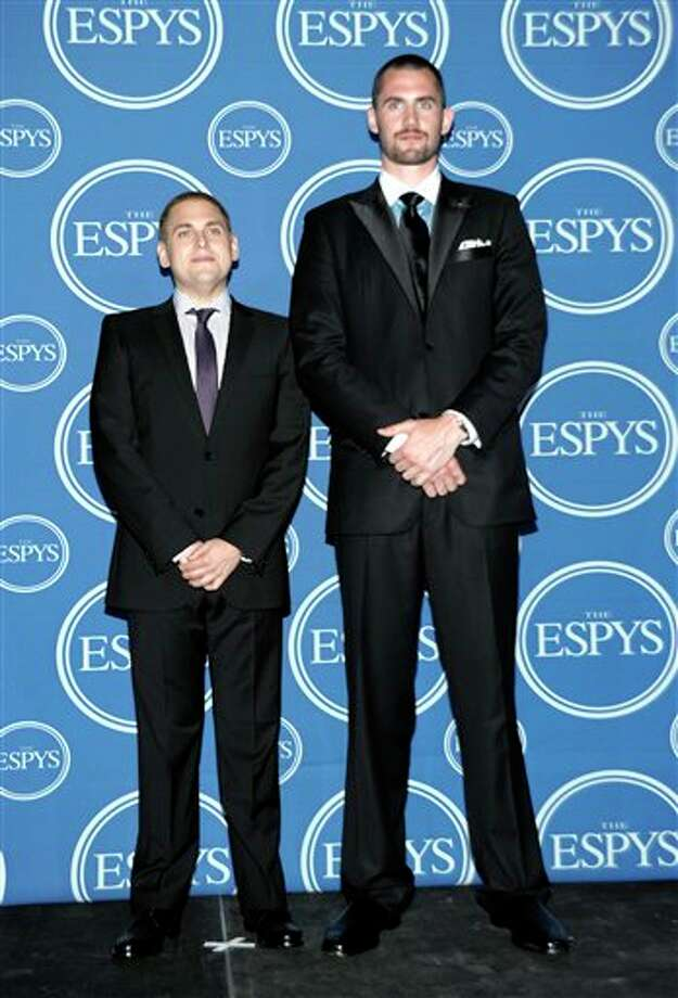 L to R, Jonah Hill and Minnesota Timberwolves Kevin Love pose backstage at the ESPY awards on Wednesday, July 13, 2011, in Los Angeles. (AP Photo/Dan Steinberg) Photo: Associated Press