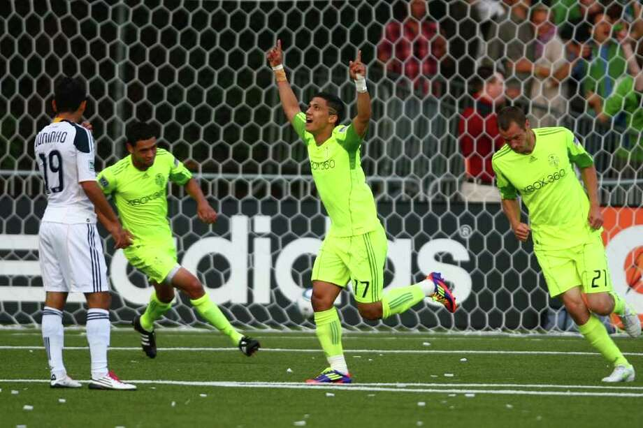 Seattle Sounders player Fredy Montero celebrates his first-half goal against the LA Galaxy during a U.S. Open Cup quarterfinal match at Starfire Sports Complex in Tukwila on Wednesday, July 13, 2011. The Sounders defeated the Galaxy 3-1. Photo: JOSHUA TRUJILLO / SEATTLEPI.COM