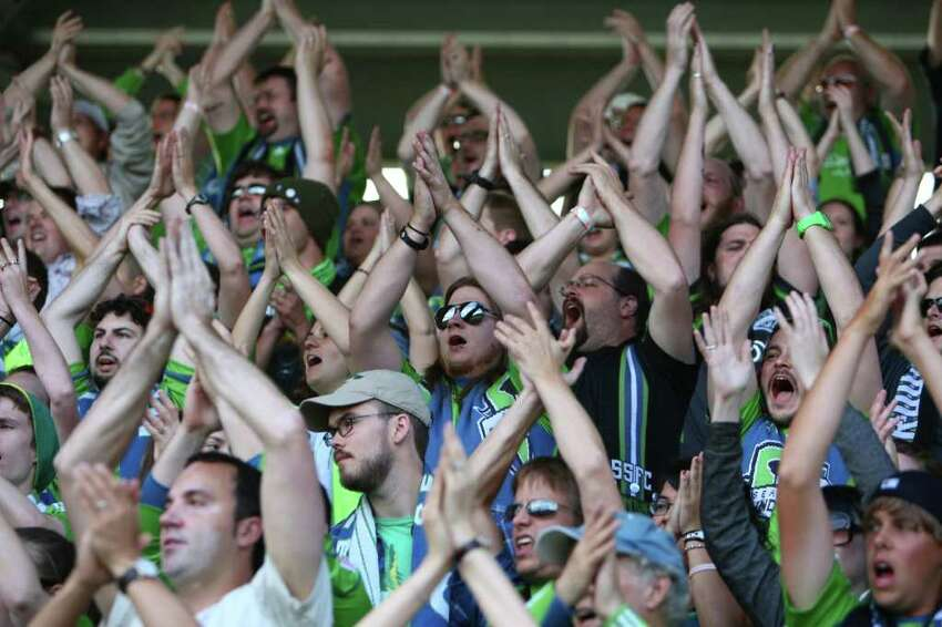 Seattle Sounders fans cheer their team against the Los Angeles Galaxy during the first half of a U.S. Open Cup quarterfinal match at Starfire Sports Complex in Tukwila on Wednesday, July 13, 2011. The Sounders defeated the Galaxy 3-1.