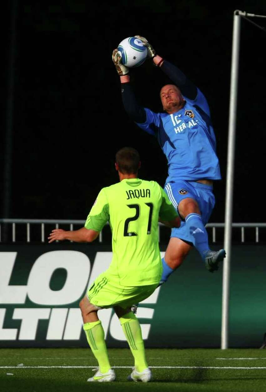 LA Galaxy goalie Josh Saunders stops a goal attempt by Seattle Sounders player Nate Jaqua during the first half of a U.S. Open Cup quarterfinal match at Starfire Sports Complex in Tukwila on Wednesday, July 13, 2011. The Sounders defeated the Galaxy 3-1.