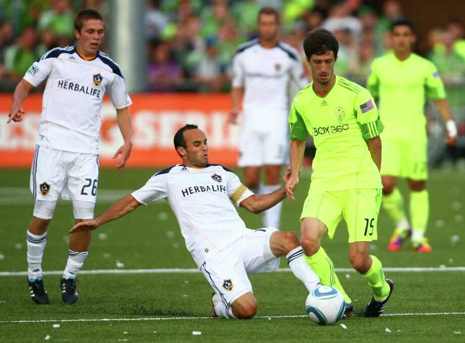 Seattle Sounders player Alvaro Fernandez (15) tries to keep the ball from LA Galaxy player Landon Donovan during the first half of a U.S. Open Cup quarterfinal match at Starfire Sports Complex in Tukwila on Wednesday, July 13, 2011. The Sounders defeated the Galaxy 3-1. Photo: JOSHUA TRUJILLO / SEATTLEPI.COM
