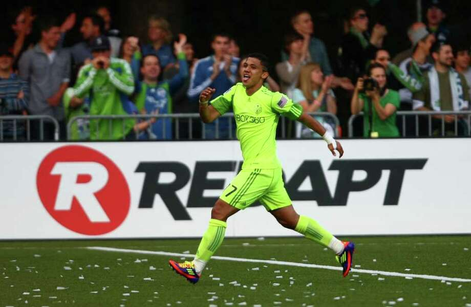 Seattle Sounders player Fredy Montero celebrates his goal against the Los Angeles Galaxy during the first half of a U.S. Open Cup quarterfinal match at Starfire Sports Complex in Tukwila on Wednesday, July 13, 2011. The Sounders defeated the Galaxy 3-1. Photo: JOSHUA TRUJILLO / SEATTLEPI.COM