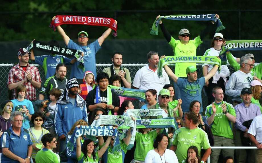 Seattle Sounders fans cheer for their team against the Los Angeles Galaxy during the first half of a U.S. Open Cup quarterfinal match at Starfire Sports Complex in Tukwila on Wednesday, July 13, 2011. The Sounders defeated the Galaxy 3-1. Photo: JOSHUA TRUJILLO / SEATTLEPI.COM