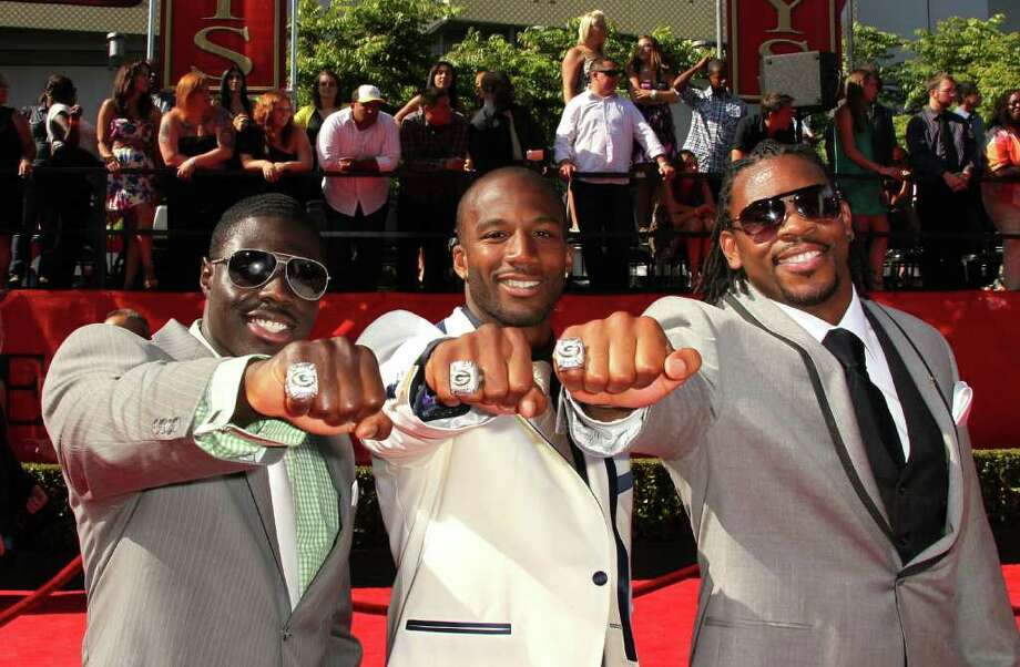 LOS ANGELES, CA - JULY 13:  NFL player's Charlie Peprah, Jarrett Bush and Desmond Bishop show off their 2011 Super Bowl rings for the Green Bay Packers arrive at The 2011 ESPY Awards at Nokia Theatre L.A. Live on July 13, 2011 in Los Angeles, California. Photo: Frederick M. Brown, Getty Images / 2011 Getty Images