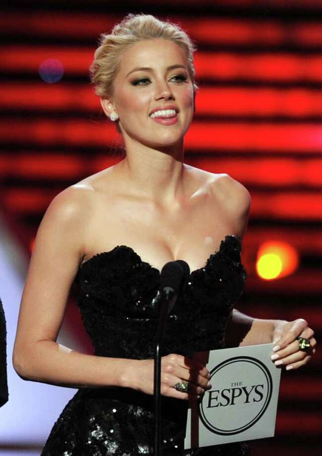 LOS ANGELES, CA - JULY 13: Actress Amber Heard  speaks onstage at The 2011 ESPY Awards at Nokia Theatre L.A. Live on July 13, 2011 in Los Angeles, California. Photo: Kevin Winter, Getty Images / 2011 Getty Images
