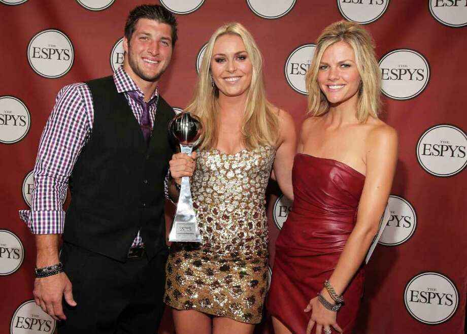 LOS ANGELES, CA - JULY 13:  (L-R) NFL player Tim Tebow, ESPY winner of Best Female Athlete Olympic downhill skier Lindsey Vonn and actress/model Brooklyn Decker attend The 2011 ESPY Awards at Nokia Theatre L.A. Live on July 13, 2011 in Los Angeles, California. Photo: Christopher Polk, Getty Images For ESPN / 2011 Getty Images