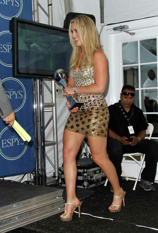 LOS ANGELES, CA - JULY 13:  Skier Lindsey Vonn walks in to the press room after winning the ESPY for Best Female Athlete at The 2011 ESPY Awards at Nokia Theatre L.A. Live on July 13, 2011 in Los Angeles, California. Photo: Frederick M. Brown, Getty Images / 2011 Getty Images