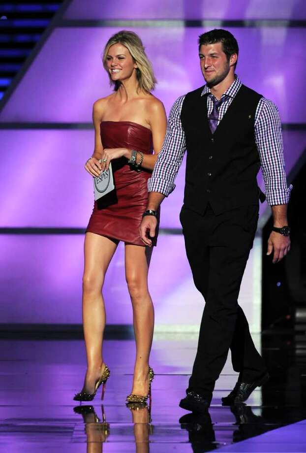 LOS ANGELES, CA - JULY 13:  Actress Brooklyn Decker (L) and NFL Player Tim Tebow speak onstage at The 2011 ESPY Awards at Nokia Theatre L.A. Live on July 13, 2011 in Los Angeles, California. Photo: Kevin Winter, Getty Images / 2011 Getty Images