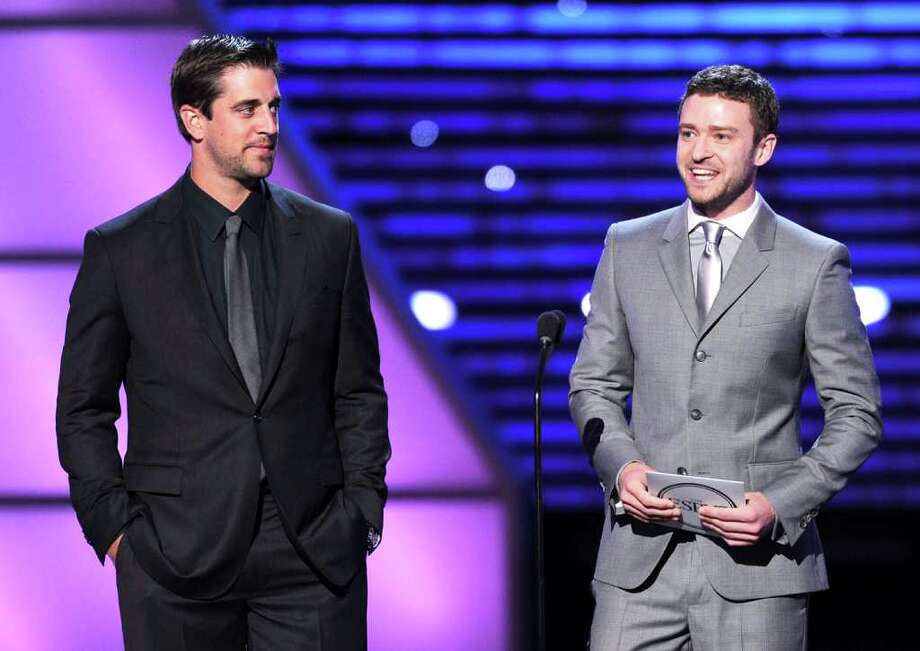 LOS ANGELES, CA - JULY 13:  (L-R) NFL player Aaron Rodgers and actor Justin Timberlake present the ESPY for Best Male College Athlete during The 2011 ESPY Awards at Nokia Theatre L.A. Live on July 13, 2011 in Los Angeles, California. Photo: Kevin Winter, Getty Images / 2011 Getty Images