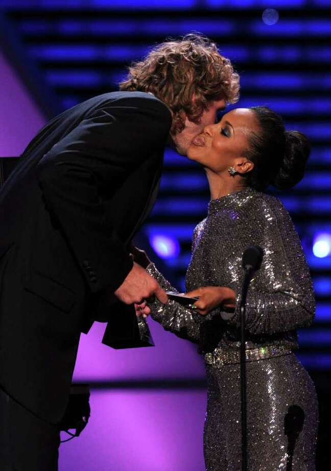 LOS ANGELES, CA - JULY 13:  NBA Player Dirk Nowitzki accepts the award for Best Male Athlete from actress Kerry Washington onstage at The 2011 ESPY Awards at Nokia Theatre L.A. Live on July 13, 2011 in Los Angeles, California. Photo: Kevin Winter, Getty Images / 2011 Getty Images