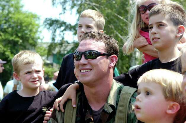 GHS graduate and Navy SEAL Carl Higbie takes center stage with a group of kids that will be his nieces and nephews after he is married next week to GHS sweetheart Kaitlyn Caruso. Higbie took part in the SEAL's demonstration at the