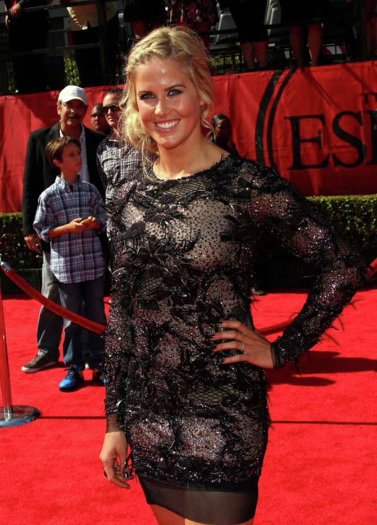 Sarah Burke: D Skier Sarah Burke's feathered and bejeweled dress looks like a reject from the