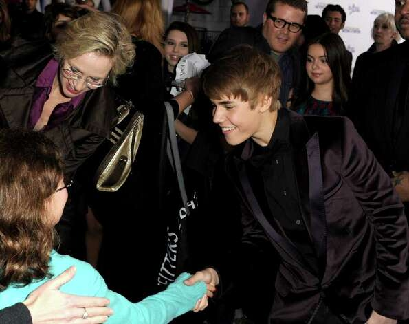 "LOS ANGELES, CA - FEBRUARY 08:  Actress Jane Lynch (L) and singer Justin Bieber arrive at the premiere of Paramount Pictures' ""Justin Bieber: Never Say Never"" held at Nokia Theater L.A. Live on February 8, 2011 in Los Angeles, California.  (Photo by Kevin Winter/Getty Images) *** Local Caption *** Justin Bieber;Jane Lynch Photo: Kevin Winter, Getty Images / 2011 Getty Images"