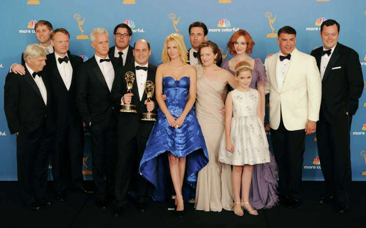 """""""Mad Men"""" lead the way with 19 total Emmy nominations. The show could repeat for the 4th year as Best Drama Series. Jon Hamm and Elizabeth Moss were nominated for their lead actor and actress roles, while Christina Hendricks and John Slattery were nominated in the supporting categories."""