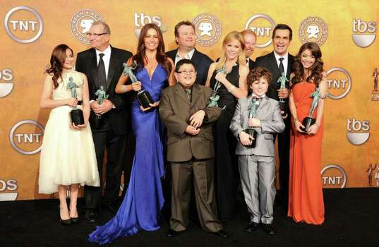 "LOS ANGELES, CA - JANUARY 30:  (L-R) Actors Ariel Winter, Ed O'Neill, Sofia Vergara, Rico Rodriguez, Eric Stonestreet, Julie Bowen, Nolan Gould, Jesse Tyler Ferguson, Ty Burrell and Sarah Hyland of the cast of ""Modern Family,"" winners of Outstanding Performance by an Ensemble in a Comedy Series award, pose in the press room during the 17th Annual Screen Actors Guild Awards held at The Shrine Auditorium on January 30, 2011 in Los Angeles, California.  (Photo by Jason Merritt/Getty Images) *** Local Caption *** Ariel Winter;Ed O'Neill;Sofia Vergara;Rico Rodriguez;Eric Stonestreet;Julie Bowen;Nolan Gould;Jesse Tyler Ferguson;Ty Burrell;Sarah Hyland Photo: Jason Merritt, Getty Images / 2011 Getty Images"